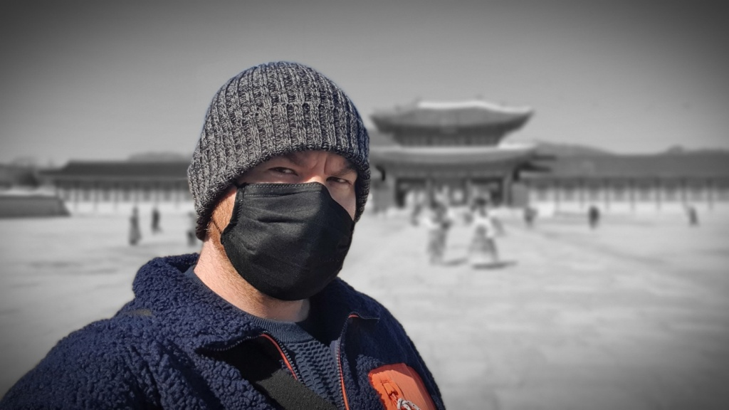 Standing in front of Gyeonbuk Palace in Seoul, South Korea