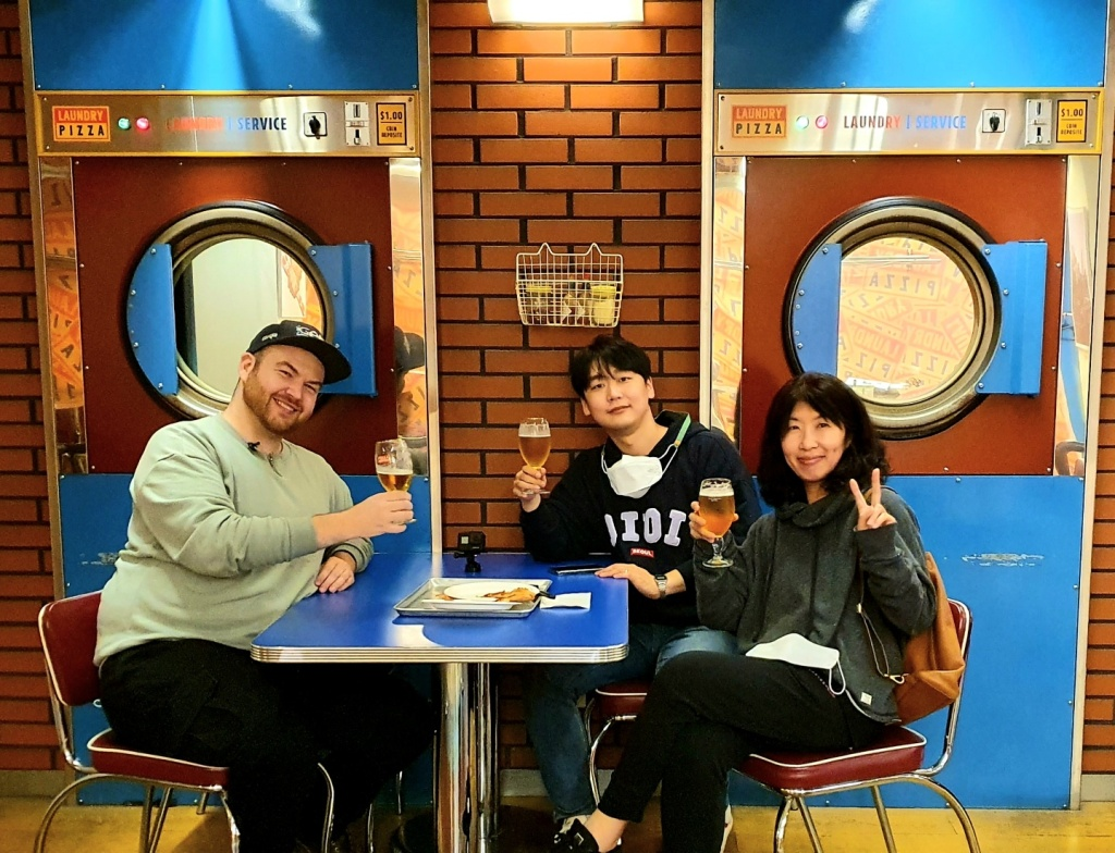 Paul from 'Tastes Seoul Good' at Laundry Pizza in Seoul, South Korea with staff from 'Discover Korea Live'. Check out this segment on November 19, 2020!